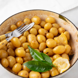 braised baby potatoes in bowl with fork and knife