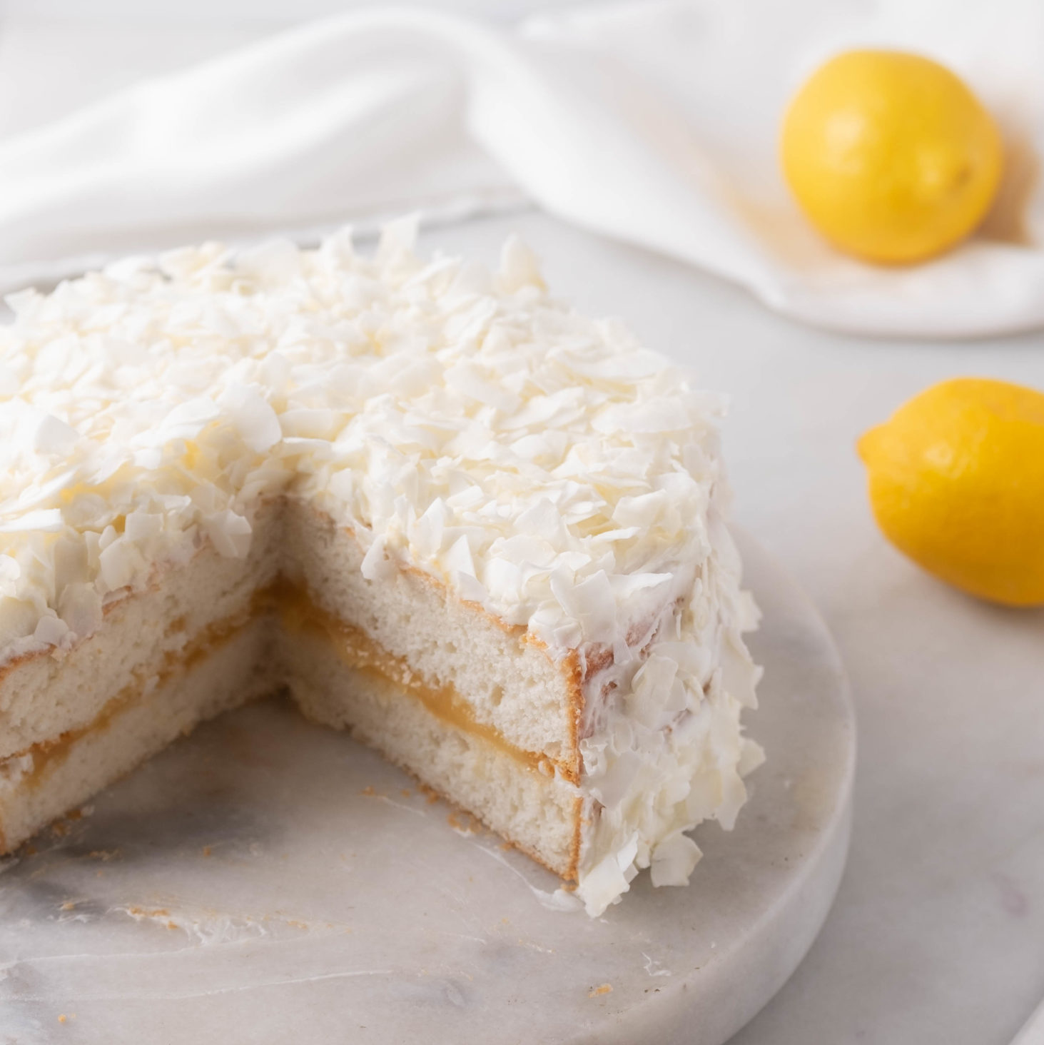 coconut cake out of a boxed cake mix sliced with lemons