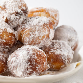 brioche donut holes with powdered sugar close up